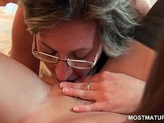Blonde mature lesbian in glasses licks and fingers pussy
