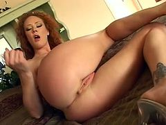 Frizzy kinky redhead called Audrey Hollander plays with black dildo