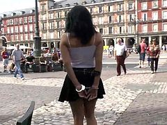 Pamela upset her dominant partner, who decided to put her hands in shackles, while they walk down the crowded piazza. But that is not enough! She has to carry a tray tied to her neck collar. Sounds disgraceful, isn't it? Watch her asking for a drink and bringing it to the guy under the passers-by regards!