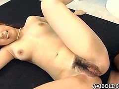 Busty Japanese lady sucks dick and gets hairy twat poked missionary