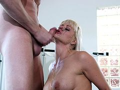 Do busty milfs fill your lusty fantasies? A horny blonde bitch shows her naked body in front of the camera in all its splendor. The slut seems excited to get on knees and demonstrate her talents, regarding the art of blowing. Watch her swallowing right down to the balls, until her makeup gets messy... Enjoy!