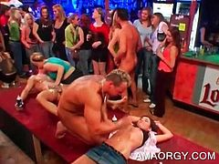 Naked tempting strippers get cock mouth fucked in big orgy