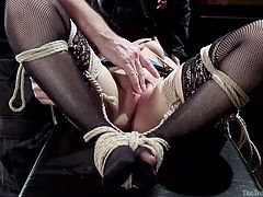Hot Gabriella is bound in the basement while getting her mouth and throat stuffed full of cock. Her executor, meanwhile, is adjusting her ropes and doing other things to her, while she gets throated. Next, her bonds are re-done, so her feet are tied to her hands, pussy presented for a good, hard fucking.