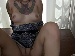 Hottie punk babe wanted to show, how naughty she can get, when she wants to. And that's what brought the slut out of her, as she stripped and showed her tattooed naked body. She let the lucky cam-guy play with her boobs and nipples, before she went down and licked the cock with sucking it good!