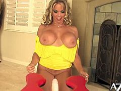 Amber Lynn Bach rides the Rocker for the very first time and you get to watch as she loses her rocker virginity. She first warms up to it by stroking the big fake cock between her huge natural boobs. Then she lowers herself over it and rocks until her wet pussy cums.