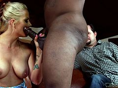 Holly is a blonde-haired milf with gorgeous big tits. The bitch is very dynamic and she gets turned on easily, when seeing a black guy's cock. She seduces the man with her charming presence and hot body. Once she reveals her tits and gets undressed, the atmosphere becomes even more hot. See the milf sucking cock!