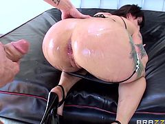 She is all oiled up and ready for a fuck. The tattooed slut gives her man a titjob, before he quickly pulls down her bikini bottom, to get at her asshole. He rams her hard with his big cock. She loves getting plowed.