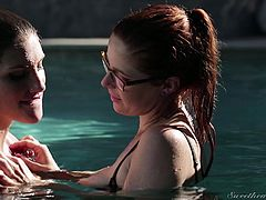 When these two amazing looking lesbians get in the water together, they get really horny. The elegant lesbians kiss each other and make out like dirty sluts in the water. They take off their bikinis and press up close to one another.