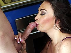 The horny milf in the video is decided to spend a lovely morning. The atmosphere in the kitchen grows hotter, when she reveals her splendid big tits, which seem to ask to be licked. After passionate kisses, the bitch undresses and gets down on knees near the oven, where starts sucking cock down to the balls.