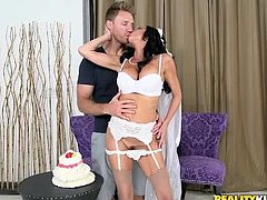 This milf gets picked up right on her wedding day and gets fucked hard, while still wearing her veil and garters. She is fingered and enjoys some cake with her new lover. They deeply kiss each other in a sensual way