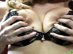 Blonde with juicy jugs and trimmed twat spreads her legs to fuck herself with toy