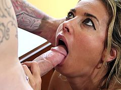 It was not an ordinary day for Damon, as he was getting an unexpected surprise from the super sexy milf Alana. She first made him taking his shirts off and went down, to get her throat fucked a bit. She sucked his balls too and took her tits out, before taking the deep throat dive on that cock!