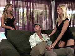 The only thing better than having one sexy blonde slut tugging and sucking on your stiff dick, is having two. One is hesitant to join in, watching the other slurp her man's cock, but she loosens up soon enough and gets in on the action, not to be outdone by her younger counterpart.