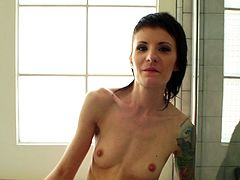 After a shower this skinny amateur girl rubs her tender clit