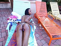 Misty Stone is the hottest ebony chick around, and she has her ass all oiled up, as she lounges on the deck chair, letting the sun shine down on her glorious black skin. Her man rubs the oil all over her, and then the couple heads inside, where Misty can suck on her boyfriend's massive black cock.
