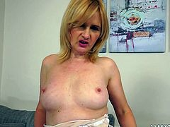 Perverted milf with small tits spreads butt cheeks wide and dildo fucks her slit
