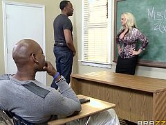 A blonde-haired busty teacher gets horny in the company of her black students. The guys circle her, while she is on knees and asks for more cock... See the lusty lady revealing her big tits. Her bra is extremely sexy and she loves face sitting, while her peachy cunt is eaten with passion. The details are hot!