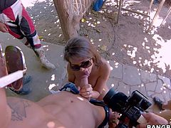 Cinthya Doll is a hot bodied sexy chick in sunglasses and sexy yellow bikini. She gets her hot mouth fucked hard by horny guy outdoors, She bares her amazing ass and gets her tits banged after blow job.