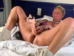 Karin is a playful mature woman with short hair and nice small tits. The bitch cannot wait to remain alone in her bedroom and try her new sex toy. Watch the slutty lady sucking a dildo with enthusiasm, while fingering her lusty pussy. The game becomes hotter, as she inserts the dildo in her cunt...