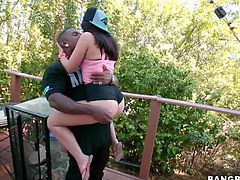 Sexy white girl Ava Dalush with sexy shapely ass and nice boobs gets down on her knees and gets her mouth filed with black huge cock in the garden. She sucks his cock and balls with passion.