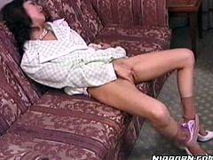 Horny Japanese housewife masturbating her list on a couch