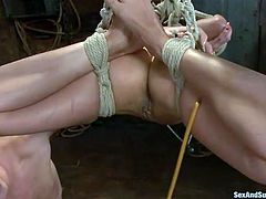 Suspended bosomy brunette gets her pussy and throat fucked