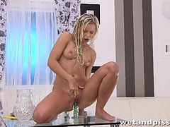 Stunning blonde Dido Angel catches her golden piss in a glass and pours it over her hot body