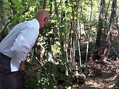 Brock loves to fuck men and when he sees the hot and sexy Kip, he can't stop thinking about him. He abducts him to a forest and ties him to a tree, where Brock gives a hand job to the blindfolded Kip and makes sure his dick is really hard and erect. He then takes it in his mouth and makes sure it's lubricated and slippery enough, to enter his own butt.