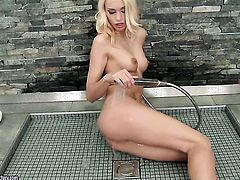 Blonde Erica Fontes has fun with dildo