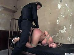 Bosomy and bootylicious tied up brunette Trina Michaels is analfucked doggy