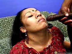 In her mouth she shoves a big dick