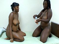 Busty ebony lesbian toys with pregnant ebony as they both use dildo to fuck each other in this free tube video.