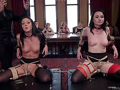Two brunette sluts are tied and twat teased on the table, and they are displayed there, while a busty blonde whore gets herself a big black cock and begins to suck it. Meanwhile, in the orgy party a redhead is dominated, collared, chained and clamped, to be tortured and fucked!
