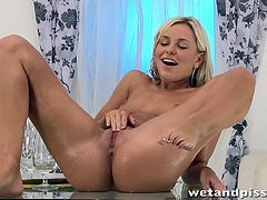 Sexy European babe Dido Angel spreads her legs and uses a douche to get her pussy nice and wet. She takes a purple vibrator to her cunt after she tears her pantyhose open. She shoves the vibrator deep inside and squirts pussy juice on the camera.