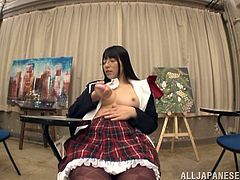This beautiful Japanese schoolgirl takes out her favorite hitachi vibrator and pleasures her pussy right in the classroom. She leans over the desk and even flashes her amazing ass. She loves to be naughty in school.