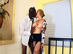 Watch how much this horny blonde milf loves her cock action, big black cock action, that is, in this free interracial tube video.