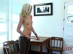 Blonde Emily Kae with tiny breasts and smooth snatch rubbing her bush