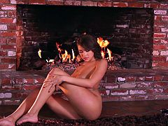 This sexy brunette loves to record herself doing sexy things, when she is alone. She wears a sexy bra and pretends, as if she is acting it out in front of her boyfriend. She then strikes several poses, before she sits on the rug with fire burning in the background, spreads her long legs wide, to give a full and clear view of her tight pussy, which she fingers very hard.
