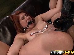 Welcome to the sinful dungeon, where slaves, like slutty Rose Red, are kept tied up strongly, or enchained. The naked redhead is wearing a mouth gag, so her moaning cannot be listened by anyone. See the dominant lesbian using a vibrator, to raise lusty pleasures and Rose, getting banged with a strap on.