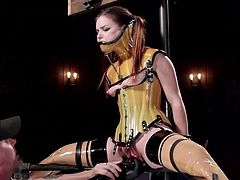 Not even in her roughest dreams had Juliette been so fiercely tied up. The slutty bitch is first the prison of a bondage device and wears a mouth gag, while her delicious pussy is stimulated with a vibrator, by a rude executor. The picture changes when the horny slave gets tied in another type of device. See!