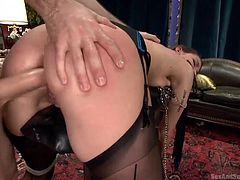 A slutty brown-haired bitch with small tits got tied up with ropes and chains, while a dominant horny guy uses her in an awful manner, to fulfill his lusty fantasies. Click to see the submissive lady keeping a whip in her mouth. Her round ass looks sensational!