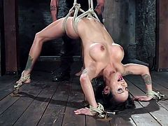 Are bdsm activities your cup of coffee? An attractive milf with gorgeous tits has been tied up and awfully bonded with strong ropes by a merciless executor. See the helpless brown-haired lady moaning of pleasure and pain, as her naughty cunt is stimulated with a vibrator and a dildo. So exciting, isn't it?