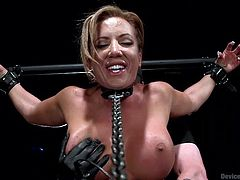 If you are interested in kinky bdsm activities, click to watch a naked blonde-haired bitch, tied up by a severe executor. The dominant guy has put her in chains, so she cannot move and get away, no matter how hard she'd try. See the busty slutty lady aroused with the help of a vibrator...