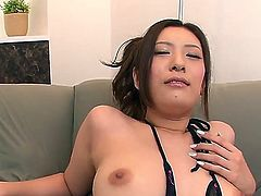 Sexy ass Japanese lady Yui Kasuga with natural tits gets her asian snatch fucked with vibrator from behind.  She gets her nipples stimulated with another toy at the same time.