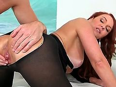 This hot redhead milf with big ass and nice tits is going to get properly rammed while wearing black stockings with an open hole right where its supposed to be.