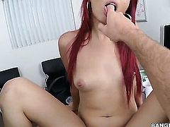 Redhead Asian gives a blow job