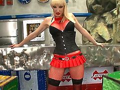 Sofia Valentine looks like a real prostitute all dressed up in red skirt and fishnet stockings. She obviously is trying to provoke us all with her stunning body while she fingers herself.