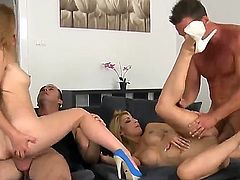 Foursome on the sofa with rough pussy penetration