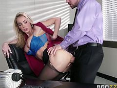 The sensual milf in the office has the power to distract any guy working there. Click to see her on knees, enjoying the taste of two horny cocks. Remaining alone with Erik, the slutty blonde gets undressed and shows him her fascinating big tits. She's really eager to get banged hard from behind. Have fun!