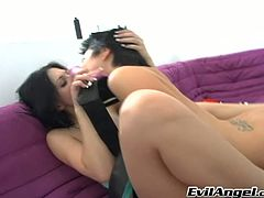 Insatiable brunette sluts please each other with massive strapon